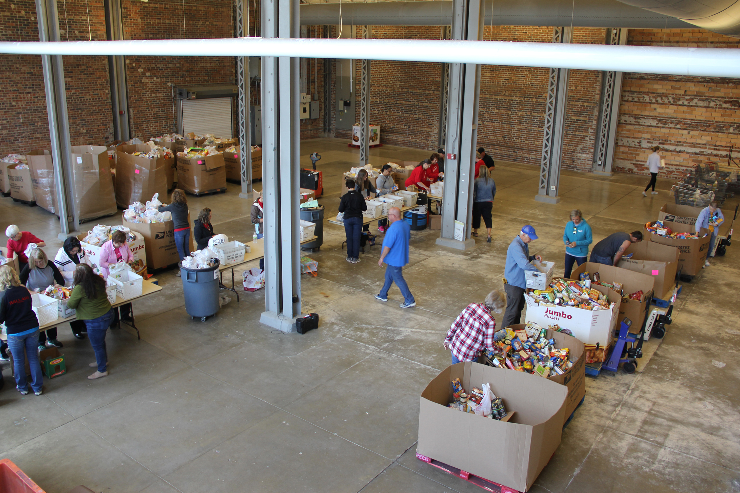 Overhead view of Stamp Out Hunger volunteers sorting food